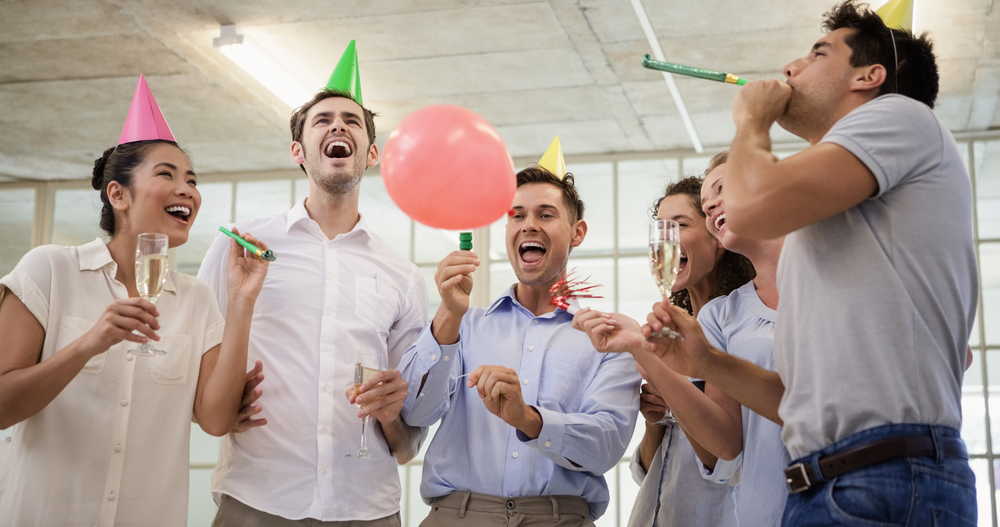 People celebrating a successful Debt Consolidation Program