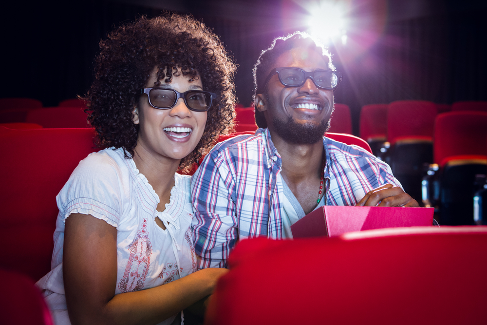 Couple enjoying a matinee show as one of 20 cheap date ideas for winter