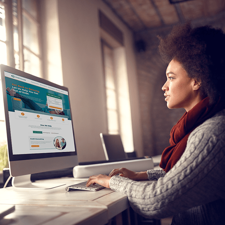 Woman looking at Credit Canada online